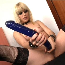 Nora, the sex fiend goth, can't stop masturbating with our giant dildoes.